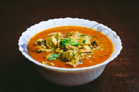 Indian Nepali Style Chicken Curry in a bowl. Meat curry