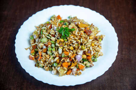 Chatpate - Vegetables with Rice Puffs snack is a popular street food in Nepal & India. Oil-free, full of veggies, light, spicy and crunchy.