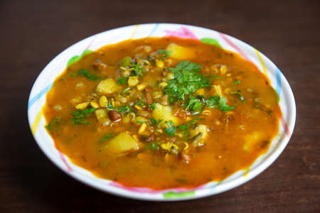 Nepali Style Potato and Sprout Beans Curry served in a bowl and garnished with cilantro,coriander leaves.
