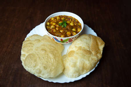 Chole Bhatura is a common dish in North India. Chole with puri or Chana Masala with Puri Indian Food. Popular Nepali Indian Snacks