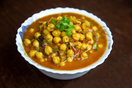 Popular Nepali Indian dish Chana Masala or Chole Masala. Especially it is served with Bhature. Puri
