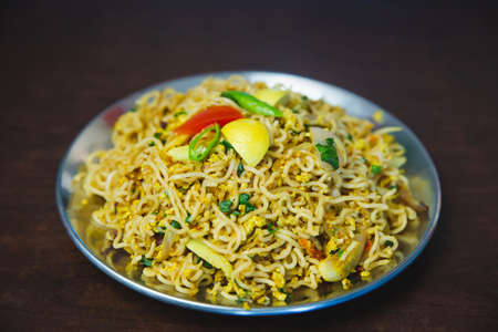 Nepali WaiWai Chowchow noodles cooked with eggs and vegetables served on a plate on the table. Chau Chau Fry Nepali Indian Style Standard-Bild