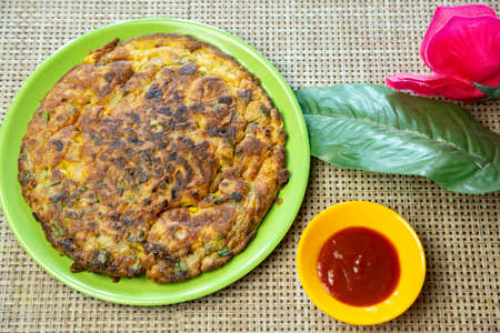 Popular Indian Nepali Style Masala Omelette recipe served on plate with tomato ketchup. Standard-Bild