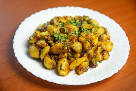 Indian Nepali Style Aloo or Alu Fry Recipe served on a plate. Potato Fry, Boiled and fried potato recipe Standard-Bild