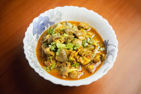 Mushroom Curry cooked in Nepali Indian Style served in a bowl.Button mushroom curry gravy Standard-Bild