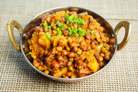 Potato and black chickpeas recipe,Alu chana in a bowl. Famous Nepali Indian recipe
