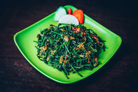 Spinach Sauteed with onions and chillies served on a plate. Spinach Recipe Standard-Bild