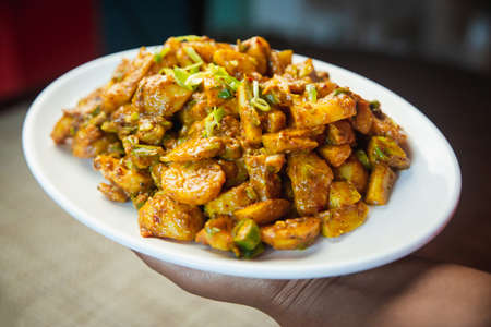 Popular Cucumber and potato pickle served on a plate. Alu kakra ko achar.Spicy Nepali Pickle Standard-Bild