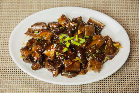 Eggplant with Soya Sauce, Soya Eggplant recipe in korean style served on a plate. Soya chilli Eggplant