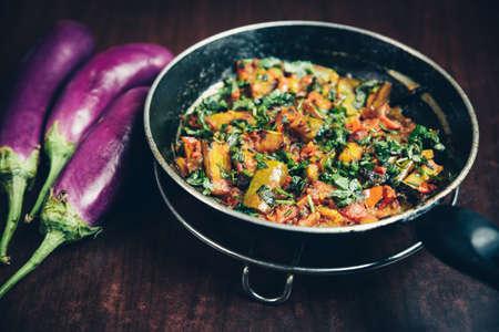 Indian Nepali Style eggplant or baingan recipe in a frying pan. Venta Aloo.