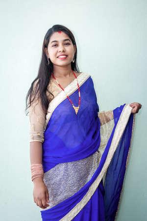 Beautiful Nepali woman with beautiful dress up with traditional ornaments. Portrait of a nepali girl or nepali woman.