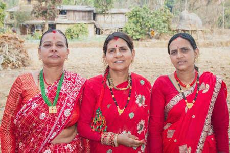 Nepali village women posing for photograph on traditional Nepali attire , Blauz and Sari. Nepali Woman.