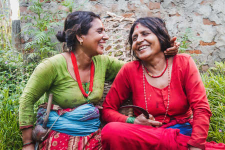 Happy Nepali women on traditional attire in the rural village of Nepal. Nepalese women Standard-Bild