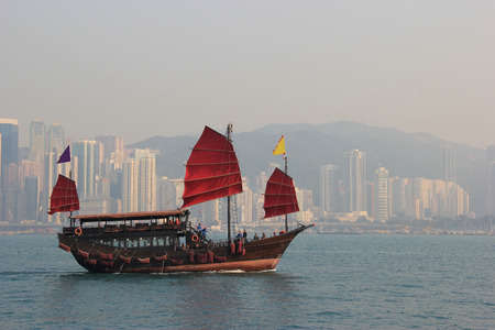 Traditional Wooden Sailboat sailing in Victoria Harbour in Hong Kong