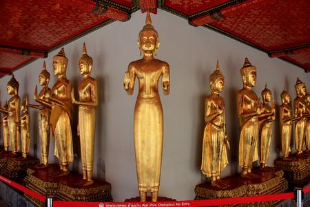 traquil scene: Buddha at Wat Chetuphonwimonmangklaram or Wat Pho in Bangkok  Thailand