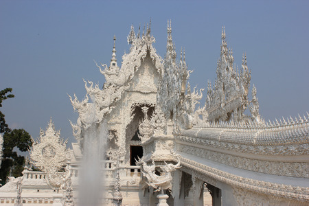 Rongkhun Temple or White Temple, a contemporary unconventional Buddhist temple in Chiangrai, Thailand photo