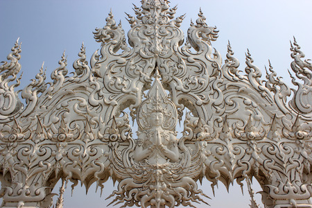 Decoration at Wat Rong Khun or White Temple, a contemporary unconventional Buddhist temple in Chiangrai, Thailand, was designed by Arjan Chalermchai Kositpipat photo