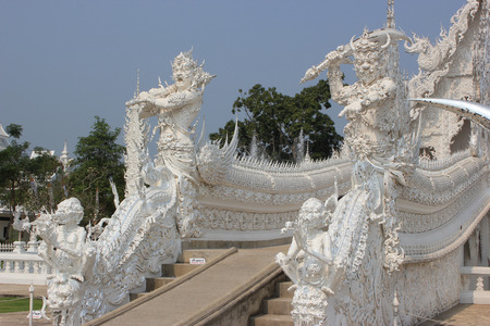 Sculpture at Wat Rong Khun or White Temple, a contemporary unconventional Buddhist temple in Chiangrai, Thailand, was designed by Arjan Chalermchai Kositpipat photo