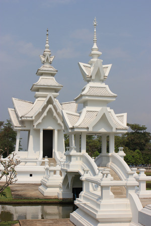 Wat Rong Khun or White Temple, a contemporary unconventional Buddhist temple in Chiangrai, Thailand, was designed by Arjan Chalermchai Kositpipat photo