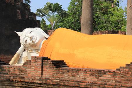 Ancient Reclining Buddha at Watyaichaimongkol Temple in Ayudhaya, Thailand photo