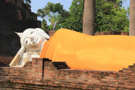 Ancient Reclining Buddha at Watyaichaimongkol Temple in Ayudhaya, Thailand photo