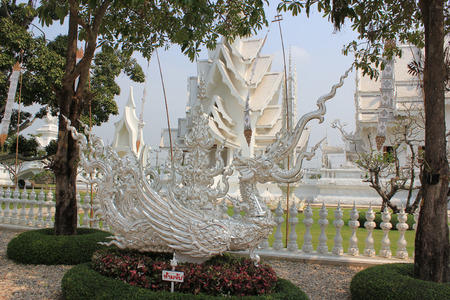 Beautiful Decoration at Wat Rong Khun or White Temple, a contemporary unconventional Buddhist temple in Chiangrai, Thailand, with white Lanna style flags photo