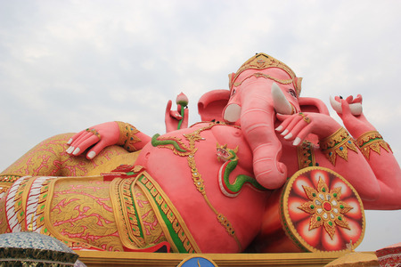 Hugh Pink Genesha, the elephant-deity riding a mouse, one of the commonest mnemonics for anything associated with Hinduism, located at Wat Samanrattanaram Temple, Chachengsao, Thailand photo