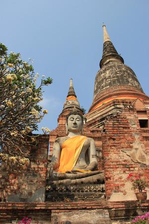 Buddha in front of Giant Pagoda at Watyaichaimongkol Temple in Ayudhaya, Thailand photo