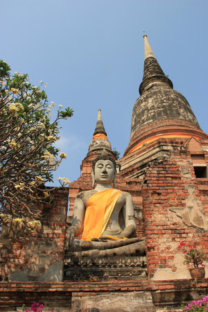 Buddha in front of Giant Pagoda at Watyaichaimongkol Temple in Ayudhaya, Thailand photo