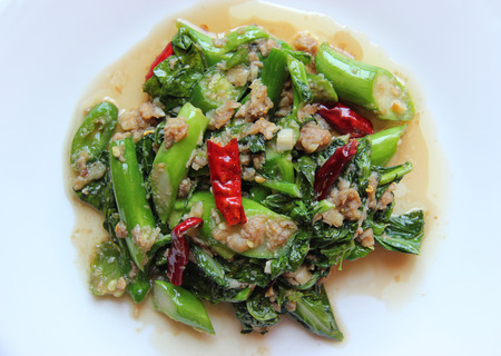 Popular Thai Food  Fried Fresh Chinese Broccoli with Salty Fish, Garlic and Chili photo