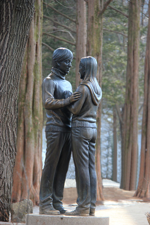 Famous Statue of Bae Yong-Joon and Choi Ji-Woo from Korean Television Drama Series Winter Sonata on Nami Island, South Korea