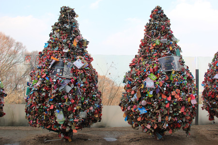 Lock of Love or Love Lock or Love Padlock, a padlock which sweethearts lock to the trees to symbolize their love, at N Seoul Tower, Seoul, South Korea photo