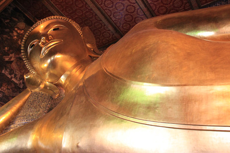 Reclining Buddha at Wat Pho or Wat Phra Chettuphon Wimon Mangkhlaram Ratchaworamahawihan or Temple of the Reclining Buddha, one of famous landmarks in Bangkok, Thailand, well known as the birthplace of traditional Thai massage