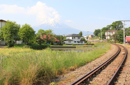 Japanese Village with Fuji Mountain in Background photo