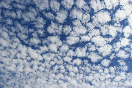 Beautiful Clouds on Bright Blue Sky Stock Photo
