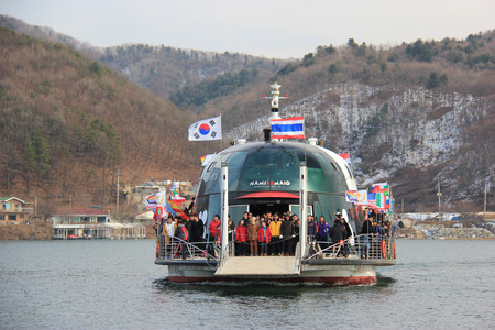 Tourists are travelling to Namiseom Island, a half moon shaped island formed as a result of the construction of the Cheongyeong Dam in South Korea.