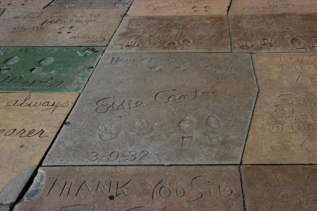 Los Angeles, California, USA - May 19, 2014: Hand and Foot Prints of Movie Stars on the Hollywood Walk of Fame on Hollywood Boulevard in Los Angeles, California