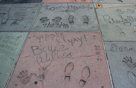 mount tom: Los Angeles, California, USA - May 19, 2014: Hand and Foot Prints of Movie Stars on the Hollywood Walk of Fame on Hollywood Boulevard in Los Angeles, California