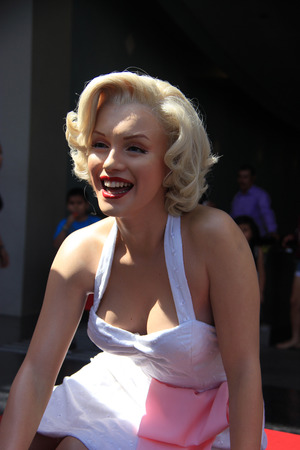 hollywood boulevard: Los Angeles, California, USA - May 19, 2014: Marilyn Monroe Statue is located in front of Madame Tussaud