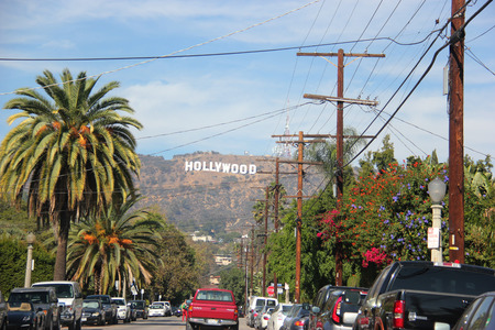 fames: Los Angeles, California, USA - November 10, 2014: The Hollywood Sign, viewed from Beachwood Drive, is a landmark and American cultural icon located on Mount Lee in the Hollywood Hills area of the Santa Monica Mountains in Los Angeles, California