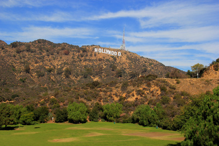 Los Angeles, California, USA - November 10, 2014: The Hollywood Sign, viewed from Lake Hollywood Park, is a landmark and American cultural icon located on Mount Lee in the Hollywood Hills area of the Santa Monica Mountains in Los Angeles, California.