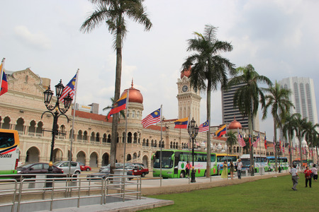 Kuala Lumper, Malaysia - April 5, 2013: The Sultan Abdul Samad Building, located in front of the Dataran Merdeka or Independence Square and the Royal Selangor Club, houses the offices of the Ministry of Information, Communications and Culture of Malaysia  Editorial