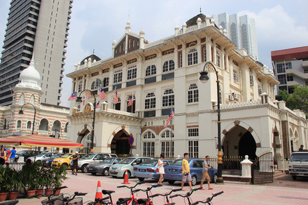 malaya: Kuala Lumpur, Malaysia - April 5, 2013: Restaurant Warisan is the three storey symmetrical building with protruding porch and arches expresses Moghul architecture eloquently. It was rebuilt after a smaller building of Malaya