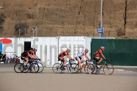 Santa Monica, California, USA - November 16, 2014: Cyclists are riding bicycles on a small street along Santa Monica Beach, California.