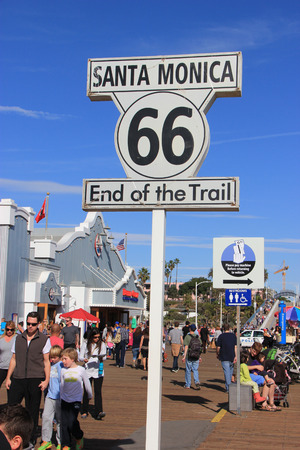 Santa Monica, California, USA - November 16, 2014: The Historic Route 66 Sign commemorates the end point of the route at Santa Monica Pier in Santa Monica, California.