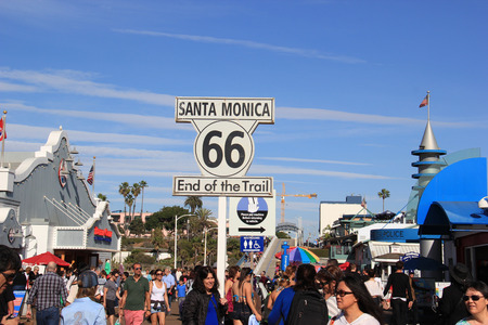 Santa Monica, California, USA - November 16, 2014: The Historic Route 66 Sign commemorates the end point of the route at Santa Monica Pier in Santa Monica, California. Stock Photo - 33914032
