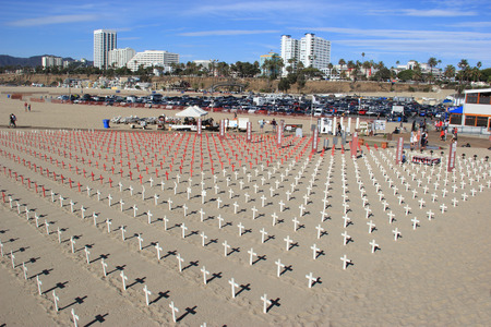 informs: Santa Monica, California, USA - November 16, 2014: Veterans for Peace, a global organization of Military Veterans and allies, informs the public of the true causes and costs of wars with an obligation to heal the wounds of wars at Santa Monica Beach, Cali