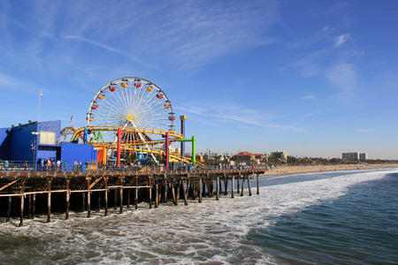 Santa Monica, California, USA - November 16, 2014: The Santa Monica Pier, 100 year old landmark, contains shops, restaurants and a family amusement park called Pacific Park, which is the only amusement park located on a pier on the west coast of the Unite