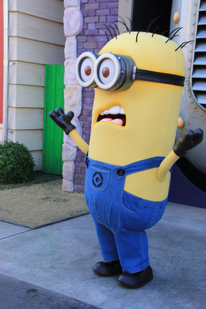universal: Los Angeles, California, USA - October 10, 2014: The character Minions is greeting tourists at Universal Studios Hollywood, which is the first film studio and theme park of Universal Studios Theme Parks across the world. Editorial