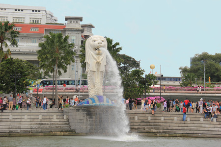 personification: Singapore - April 7, 2013: The Merlion, a statue with a lion head and a body of a fish, is the national personification of Singapore. It was designed by Alec Fraser-Brunner and has been Singapore